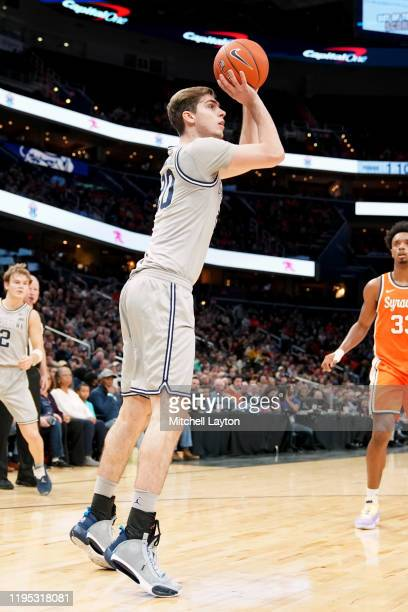 George Muresan of the Georgetown Hoyas takes a jump shot during a college basketball game against the Syracuse Orange at the Capital One Arena on...