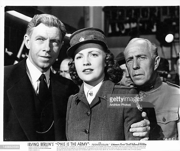 George Murphy with his arm around Joan Leslie in a scene from the film 'This Is The Army' 1943