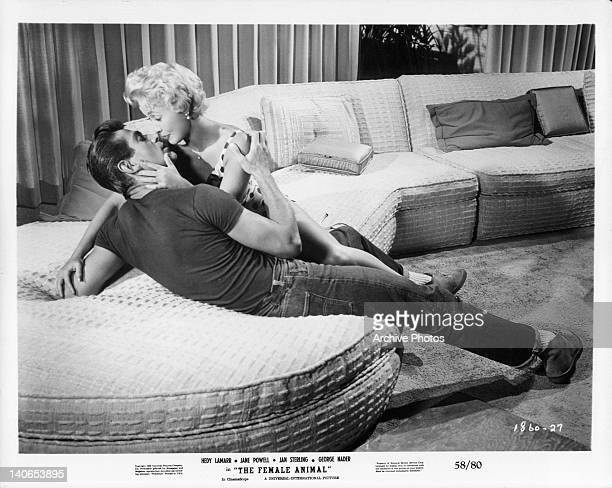 George Nader and Jane Powell are about to kiss in a scene from the film 'The Female Animal' 1958