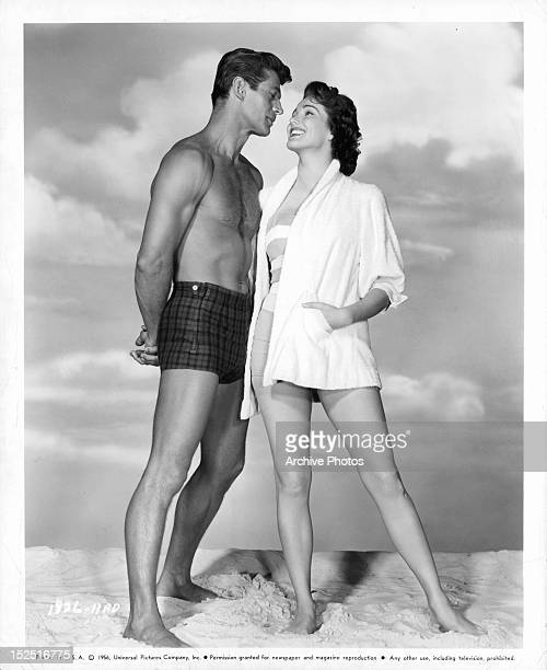 George Nader and Julie Adams smiling in publicity portrait the film 'Four Girls In Town' 1957