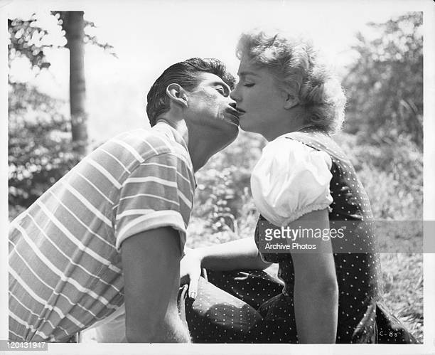 George Nader goes to kiss Anne Baxter n a scene from the film 'Carnival Story' 1954