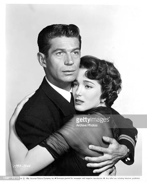 George Nader holding Julie Adams in publicity portrait for the film 'Away All Boats' 1956