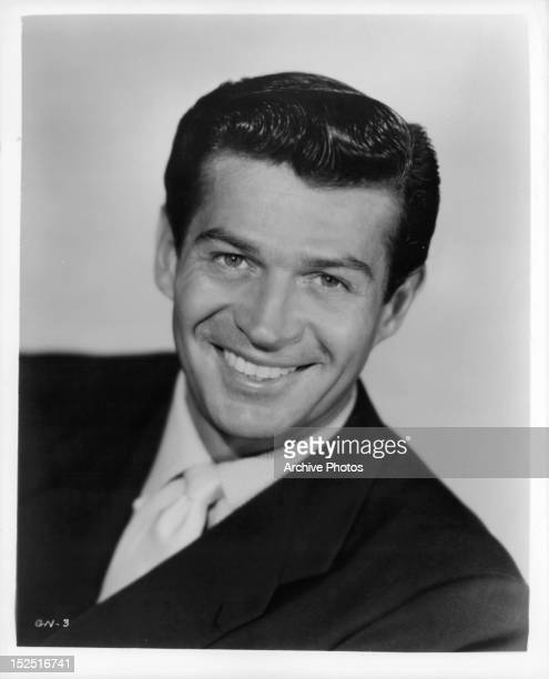 George Nader in publicity portrait the film 'Four Girls In Town' 1957