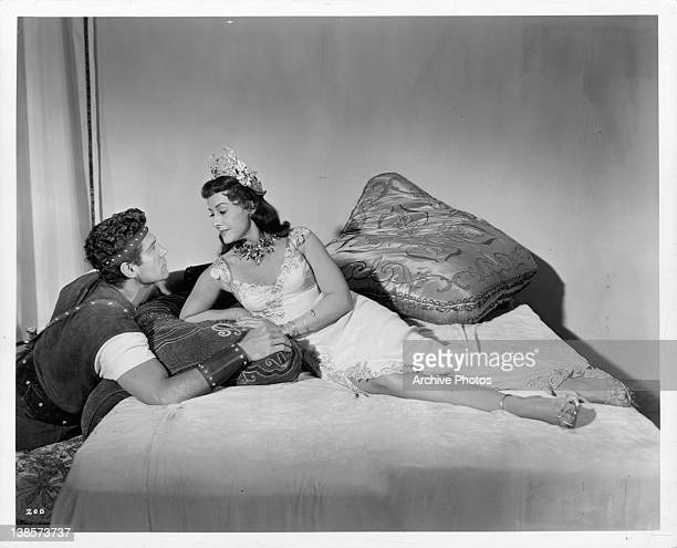 George Nader looking into the eyes of Paulette Goddard in a scene from the film 'Sins Of Jezebel' 1953