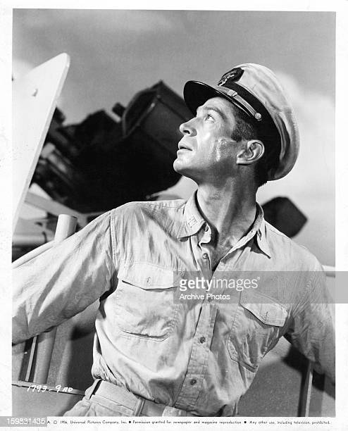 George Nader looking up in publicity portrait for the film 'Away All Boats' 1956