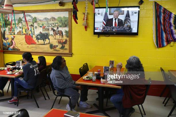 George Najera and Robert Najera dine at El Toro Bronco restaurant as President Donald Trump delivers a televised speech on January 19 2019 in El Paso...
