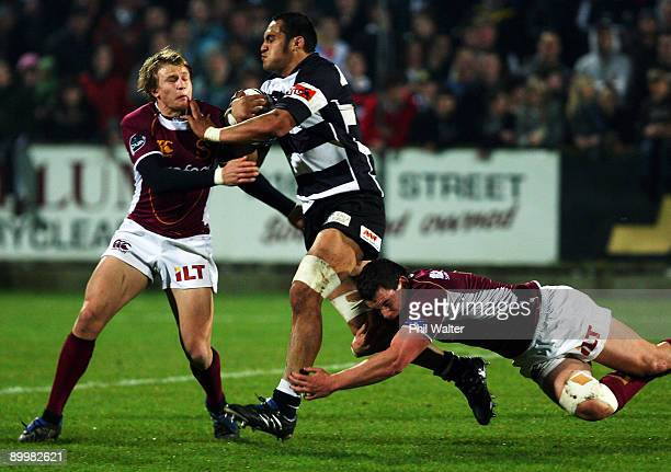George Naoupu of Hawkes Bay is stopped by the Southland defence during the Air New Zealand Cup match between Southland and Hawke's Bay at Southland...