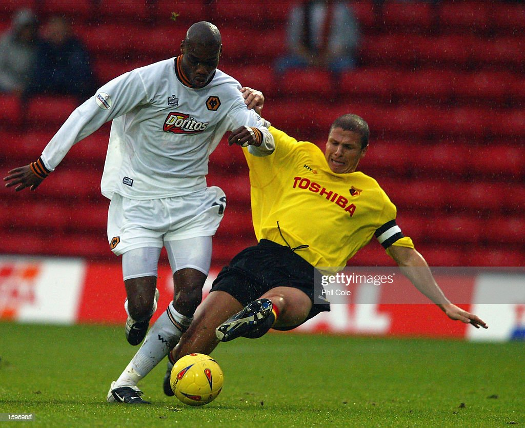 George Ndah of Wolverhampton Wanderers takes the ball past Neil Cox of Watford during the Nationwide League Division One match held on November 2, 2002 at Vicarage Road in Watford, England. The match ended in a 1-1 draw. DIGITAL