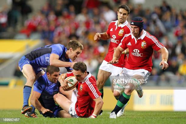 George North of British Irish Lions is tackled with Sean O'Brien of British Irish Lions following up during the tour match between the Western Force...