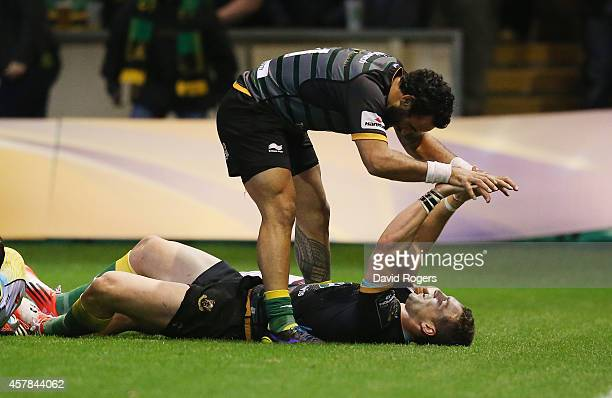 George North of Northampton celebrates with team mate Kahn Fotuali'i after scoring his fourth try of the match during the European Rugby Champions...