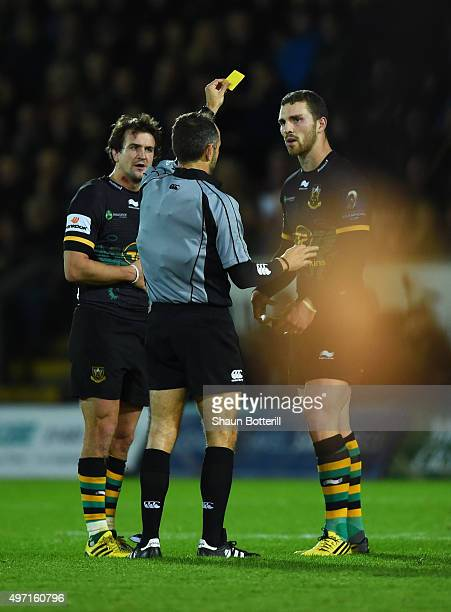 George North of Northampton is shown the yellow card by referee Romain Poite of France during the European Rugby Champions Cup Pool 3 match between...