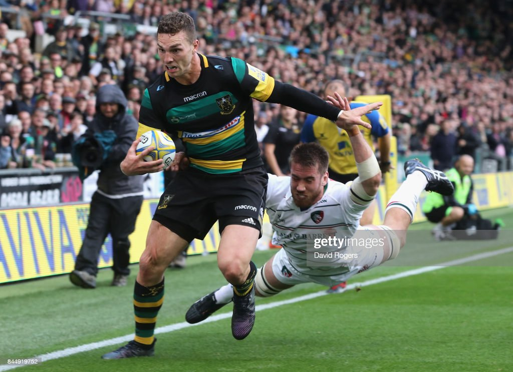 George North of Northampton moves past Dominic Ryan during the Aviva Premiership match between Northampton Saints and Leicester Tigers at Franklin's Gardens on September 9, 2017 in Northampton, England.
