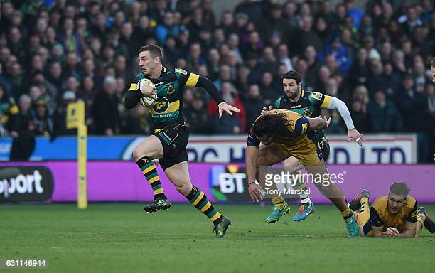 George North of Northampton Saints charges away from Thretton Palamo of Bristol Rugby during the Aviva Premiership match between Northampton Saints...