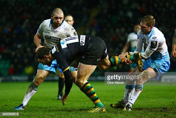 George North of Northampton Saints is hauled down by Finn Russell of Glasgow Warriors during the European Rugby Champions Cup pool three match...