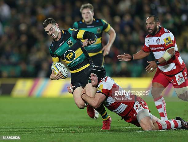 George North of Northampton Saints is stopped by the tackle of Ben Morgan of Gloucester Rugby in action during the Aviva Premiership match between...