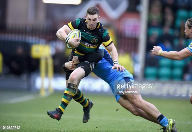 George North of Northampton Saints is tackled by Alex Lewington of London Irish during the Aviva Premiership match between Northampton Saints and...