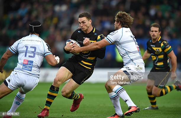 George North of Northampton Saints is tackled by Alexandre Dumoulin and Frans Steyn of Montpellier during the European Rugby Champions Cup match...