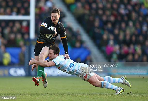 George North of Northampton Saints is tackled by Henry Chavancy of Racing Metro 92 during the European Rugby Champions Cup match between Northampton...