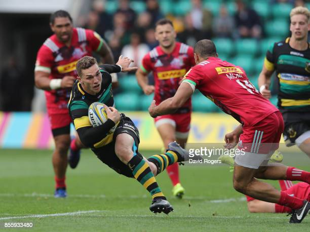 George North of Northampton Saints is tackled by Joe Marchant during the Aviva Premiership match between Northampton Saints and Harlequins at...