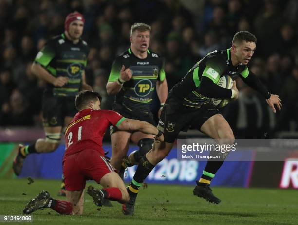 George North of Northampton Saints is tackled by Jono Kitto of Harlequins during the AngloWelsh Cup match between Northampton Saints and Harlequins...