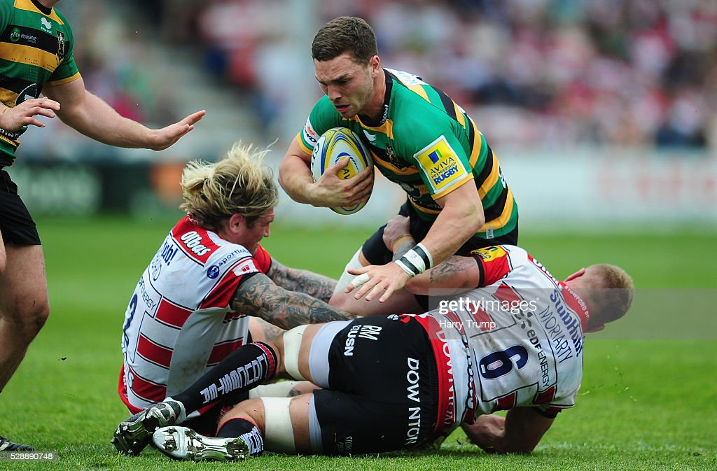 George North of Northampton Saints is tackled by Richard Hibbard of Gloucester Rugby(L) and Ross Moriarty of Gloucester Rugby during the Aviva Premiership match between Gloucester Rugby and Northampton Saints at Kingsholm on May 07, 2016 in Gloucester, England.
