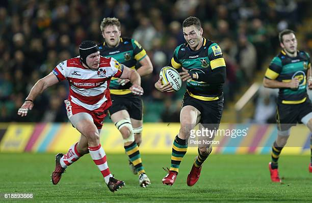 George North of Northampton Saints moves forward with the ball away from Ben Morgan of Gloucester Rugby in action during the Aviva Premiership match...