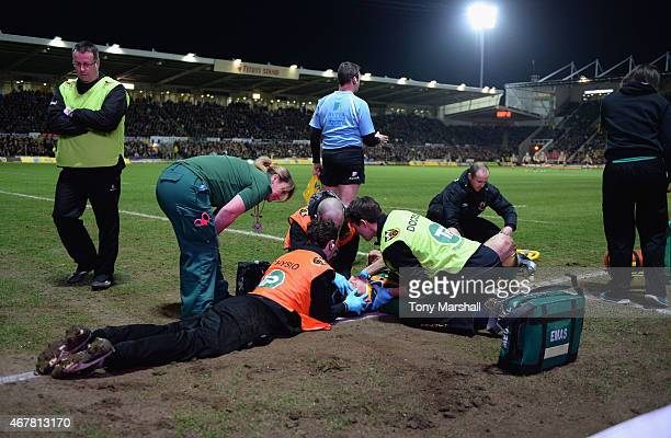 George North of Northampton Saints receives treatment after scoring a try and colliding with Nathan Hughes of Wasps during the Aviva Premiership...
