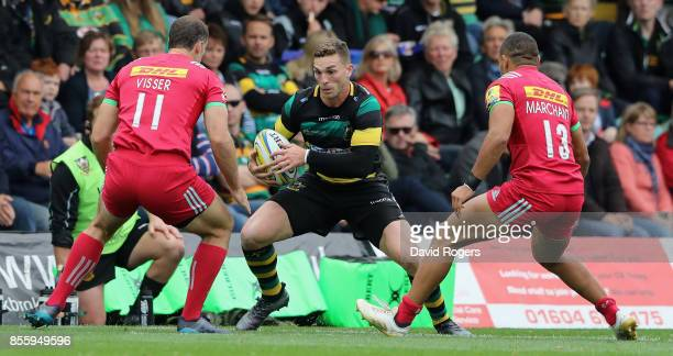 George North of Northampton takes on Tim Visser and Joe Marchant during the Aviva Premiership match between Northampton Saints and Harlequins at...