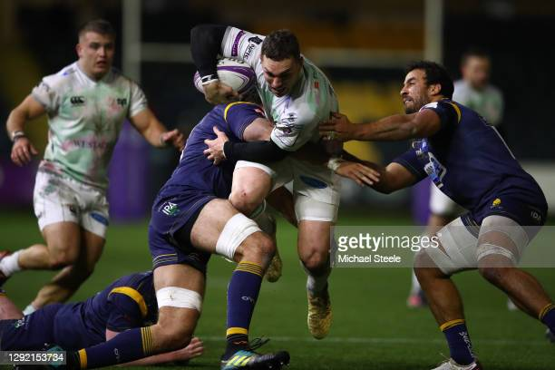 George North of Ospreys charges between Andrew Kitchener and Sam Lewis of Worcester during the European Rugby Challenge Cup match between Worcester...