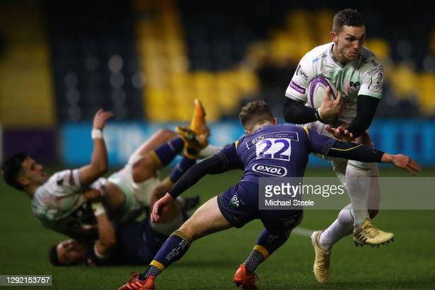George North of Ospreys charges past the challenge of Billy Searle of Worcester during the European Rugby Challenge Cup match between Worcester...