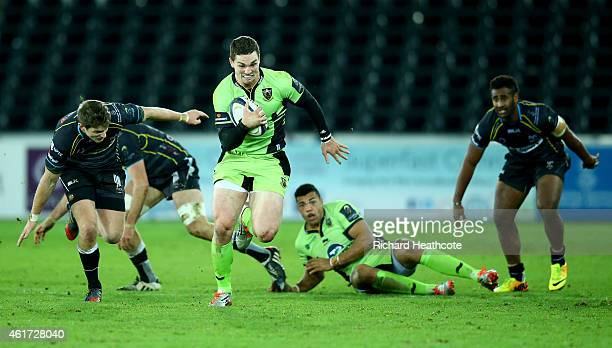 George North of Saints breaks away to score the second try during the European Rugby Champions Cup match between Ospreys and Northampton Saints at...