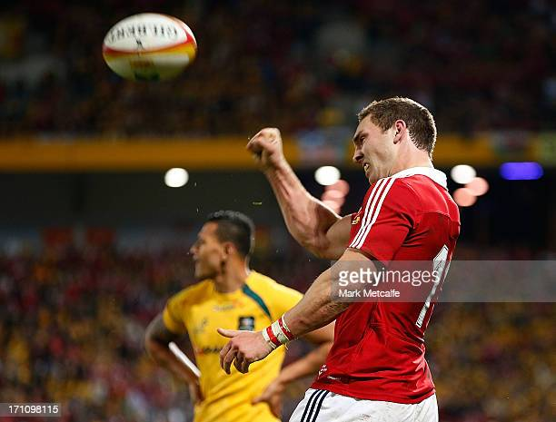 George North of the Lions celebrates scoring a try as Israel Folau of the Wallabies looks dejected during the First Test match between the Australian...