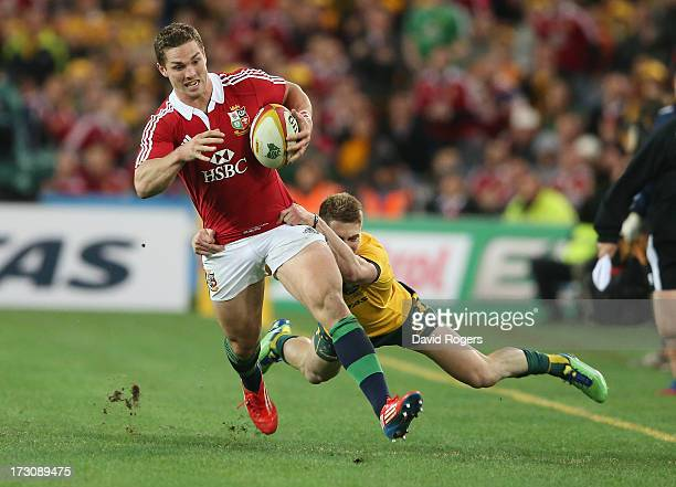 George North of the Lions is held by James O'Connor during the International Test match between the Australian Wallabies and British Irish Lions at...