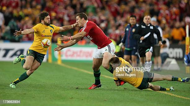 George North of the Lions is tackled by James O'Connor and Adam AshleyCooper during the International Test match between the Australian Wallabies and...