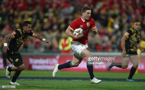 George North of the Lions runs in his team's second try during the 2017 British Irish Lions tour match between the Hurricanes and the British Irish...