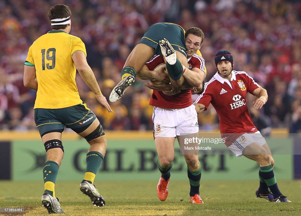 George North of the Lions tackles Israel Folau of the Wallabies during game two of the International Test Series between the Australian Wallabies and the British & Irish Lions at Etihad Stadium on June 29, 2013 in Melbourne, Australia.