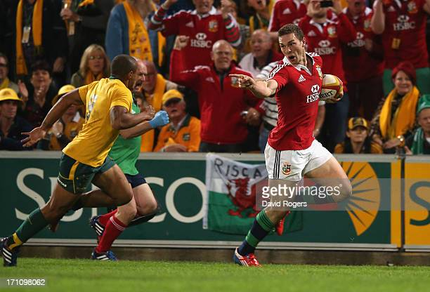 George North of the Lions taunts Will Genia as he breaks clear to score the first Lions try during the First Test match between the Australian...