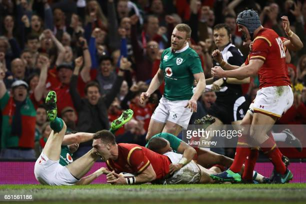George North of Wales beats the Ireland defence as he scores their first try during the Six Nations match between Wales and Ireland at the...