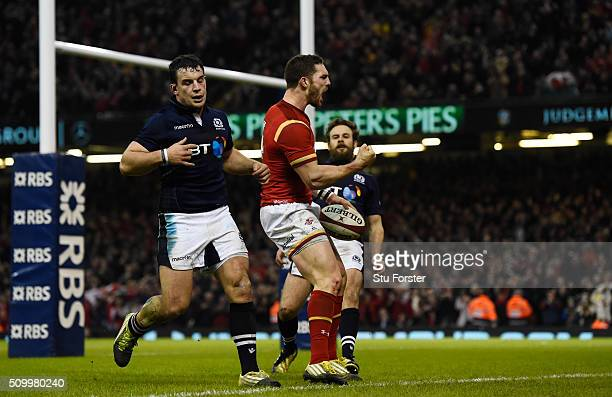 George North of Wales celebrates after scoring his team's third try during the RBS Six Nations match between Wales and Scotland at the Principality...