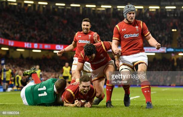 George North of Wales celebrates after scoring the opening try during the Six Nations match between Wales and Ireland at the Principality Stadium on...