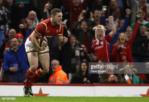 George North of Wales celebrates as he scores their second try during the Six Nations match between Wales and Ireland at the Principality Stadium on...