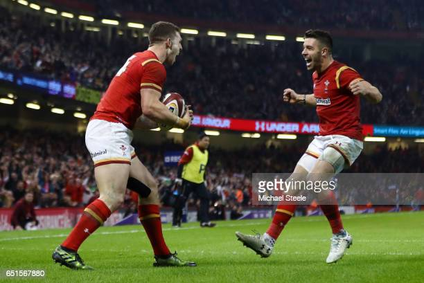 George North of Wales celebrates as he scores their second try with team mate Rhys Webb during the Six Nations match between Wales and Ireland at the...