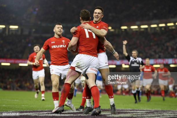 George North of Wales celebrates as he scores their second try with Owen Watkin during the NatWest Six Nations match between Wales and Italy at...