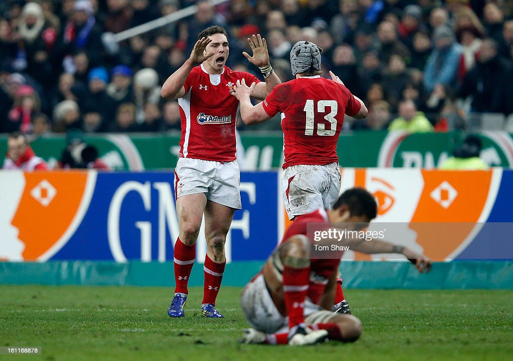 George North of Wales celebrates victory with Jonathan Davies during the RBS Six Nations match between France and Wales at Stade de France on February 9, 2013 in Paris, France.