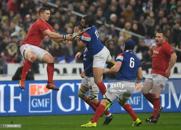 George North of Wales challenges Yoann Huget of France during the Guinness Six Nations match between France and Wales at Stade de France on February...