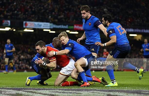 George North of Wales crashes over the line to score the opening try during the RBS Six Nations match between Wales and France at the Principality...