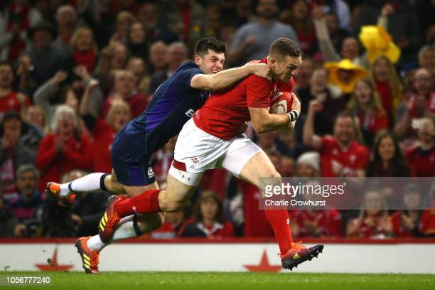 George North of Wales goes through to his sides first try while being challenged during the International Friendly match between Wales and Scotland...