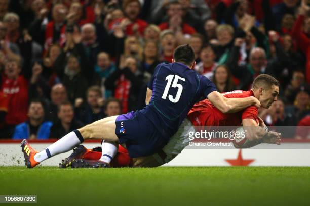 George North of Wales goes through to his sides first try while being challenged by Blair Kinghorn of Scotland during the International Friendly...