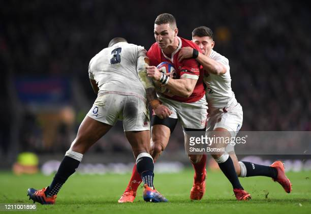 George North of Wales is tackled by Kyle Sinckler and Ben Youngs of England during the 2020 Guinness Six Nations match between England and Wales at...