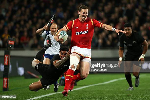 George North of Wales is tackled by Malakai Fekitoa of the All Blacks during the International Test match between the New Zealand All Blacks and...